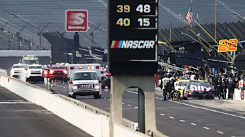 Crew member sandwiched between cars in pit crash