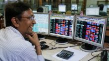 Shares end at record close, Nifty nears 10,000