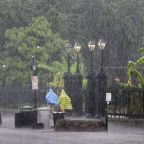 Weakened Barry unleashes a final blast of torrential rains
