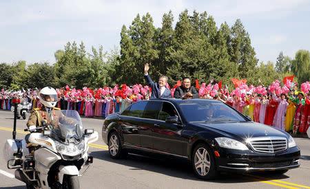 South Korean President Moon Jae-in and North Korean leader Kim Jong Un react during a car parade in Pyongyang, North Korea, September 18, 2018. Pyeongyang Press Corps/Pool via REUTERS
