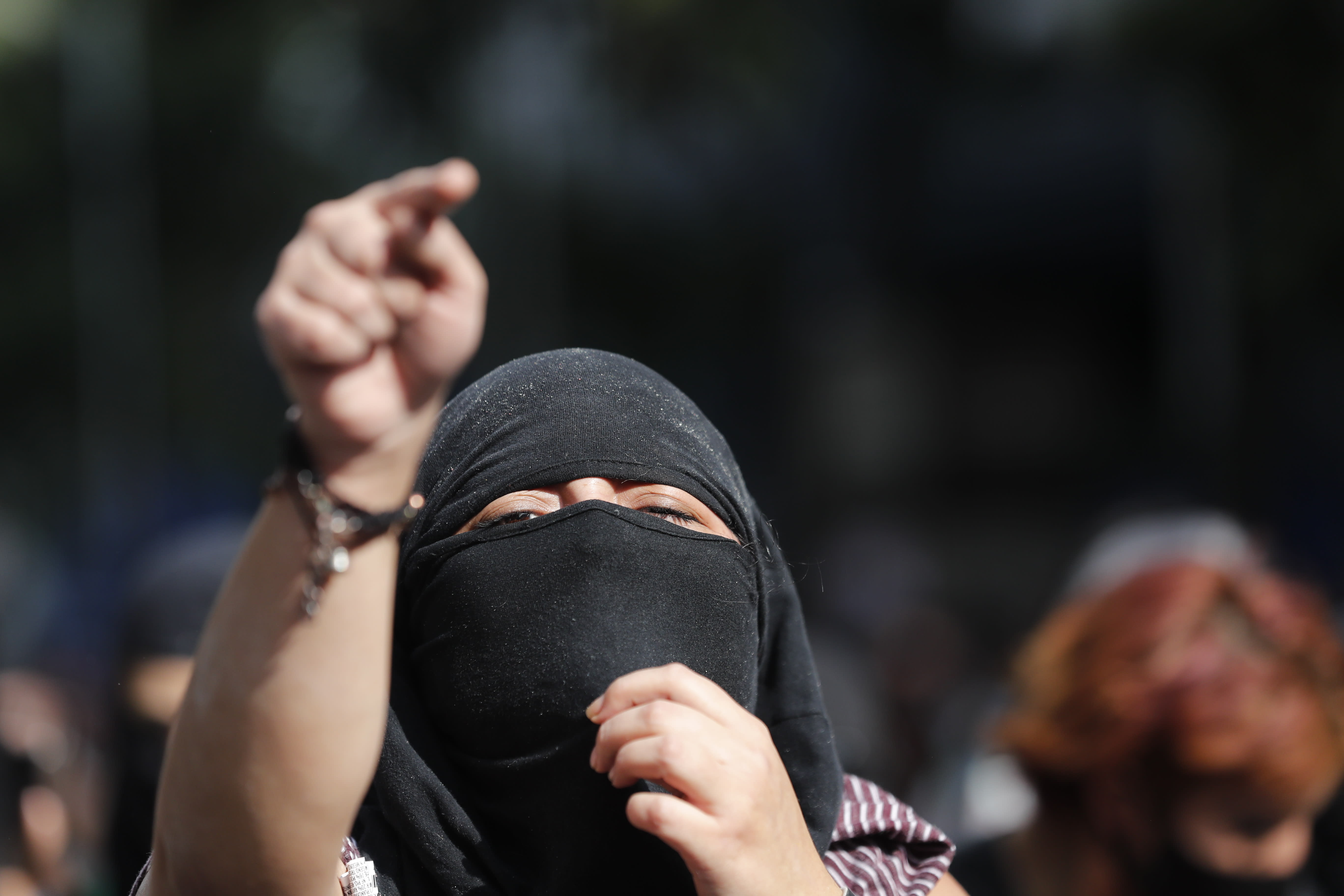 A demonstrator shouts during a march supporting abortion rights in Mexico City, Monday, Sept. 28, 2020. (AP Photo/Marco Ugarte)