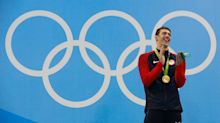 Mystery solved: Why Phelps burst into laughter atop the Olympic podium