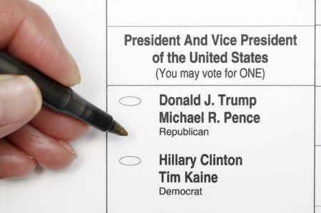 A sample ballot is seen in a photo illustration, as early voting for the 2016 general elections began in North Carolina