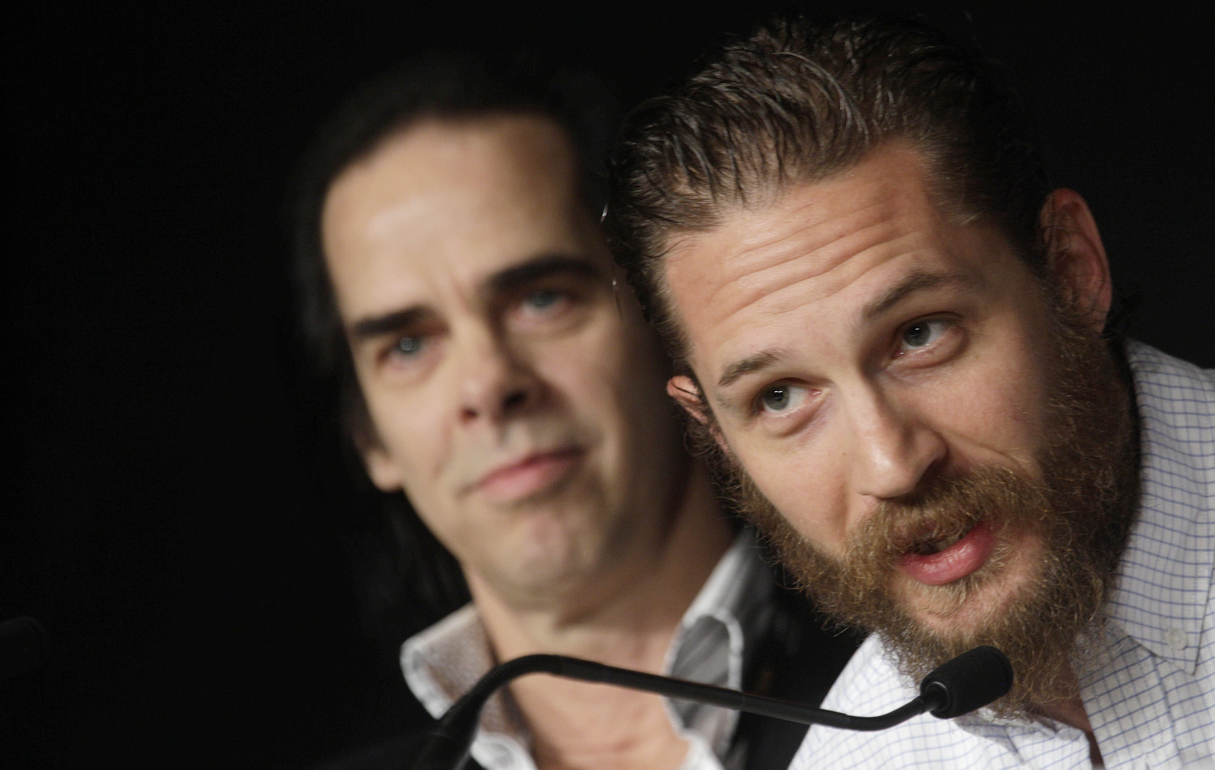 Screenwriter Nick Cave, left, and actor Tom Hardy participate in a press conference for Lawless at the 65th international film festival, in Cannes, southern France, Saturday, May 19, 2012. (AP Photo/Virginia Mayo)