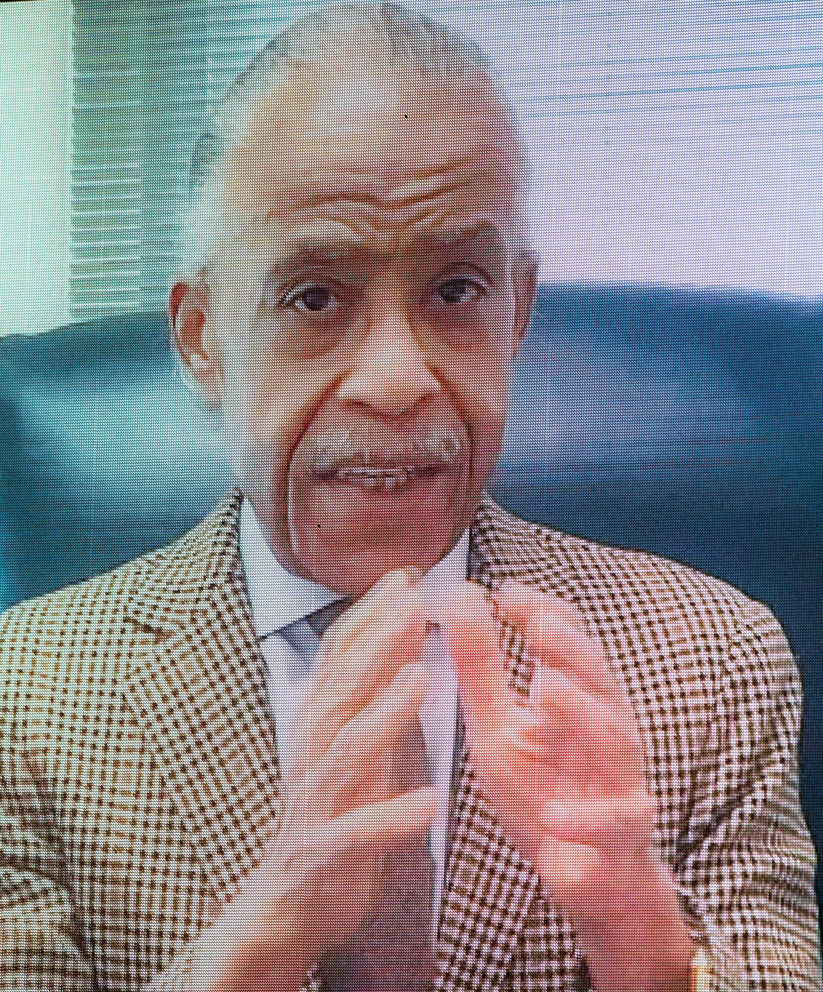 The Rev. Al Sharpton speaks via video during the funeral for Danny Ray, the famous emcee and cape man for James Brown, Saturday morning Feb. 13, 2021, at the James Brown Arena in Augusta, Ga.