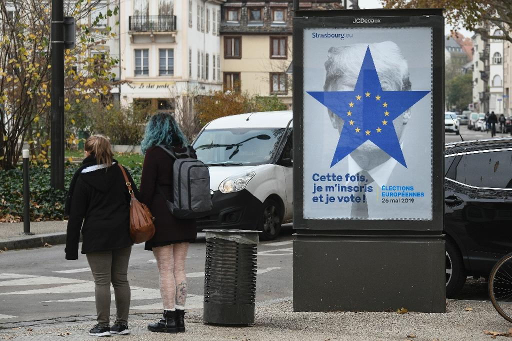 A poster depicting the twelve-star circle of the European Union flag covering the face of US President Donald Trump, part of a voter registration campaign for EU Parliament elections in Strasbourg, eastern France