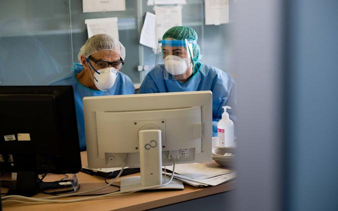 Healthcare providers in personal protective equipment.