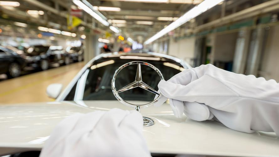 Automaker Daimler says it lost $1.3 billion on diesel vehicles and air bag recalls