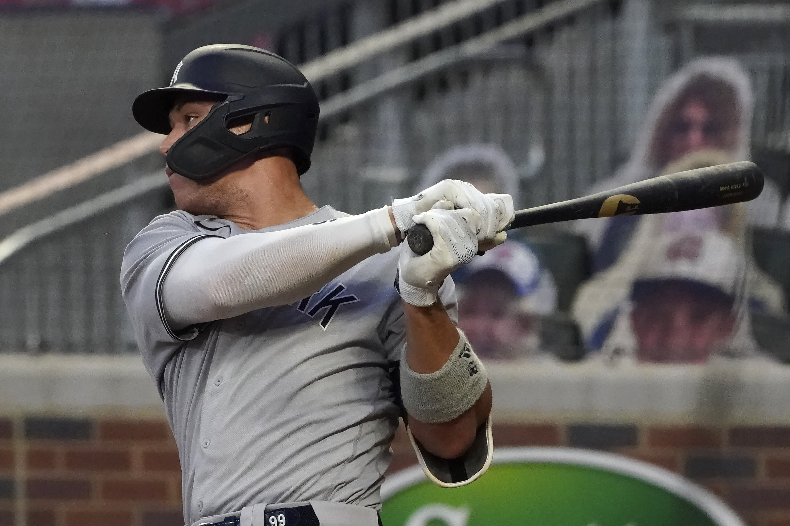 New York Yankees' Aaron Judge follows through on a single during the fourth inning of the second game of the team's baseball doubleheader against the Atlanta Braves on Wednesday, Aug. 26, 2020, in Atlanta. (AP Photo/John Bazemore)