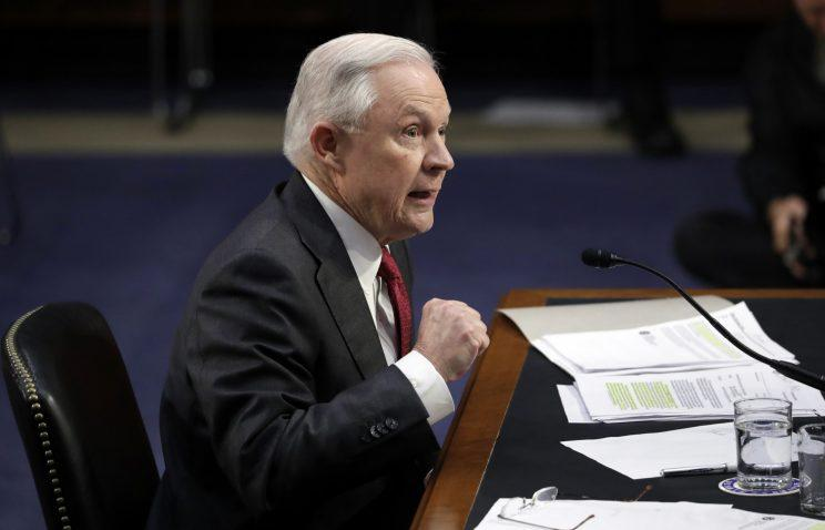 Attorney General Jeff Sessions shakes his fist as he testifies before the Senate Select Committee on Intelligence about his role in the firing of FBI Director James Comey and the investigation into contacts between Trump campaign associates and Russia, on Capitol Hill in Washington, Tuesday, June 13, 2017. (Photo: J. Scott Applewhite/AP)