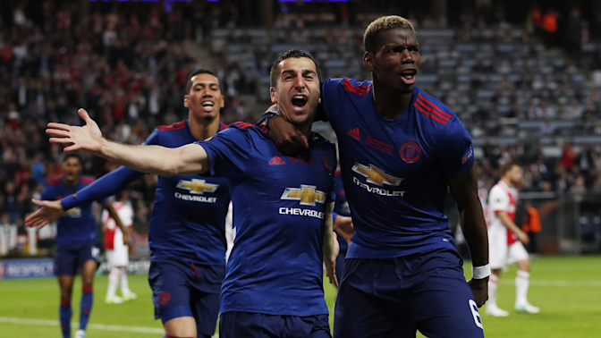 Manchester United lift Europa League trophy to secure Champions League football