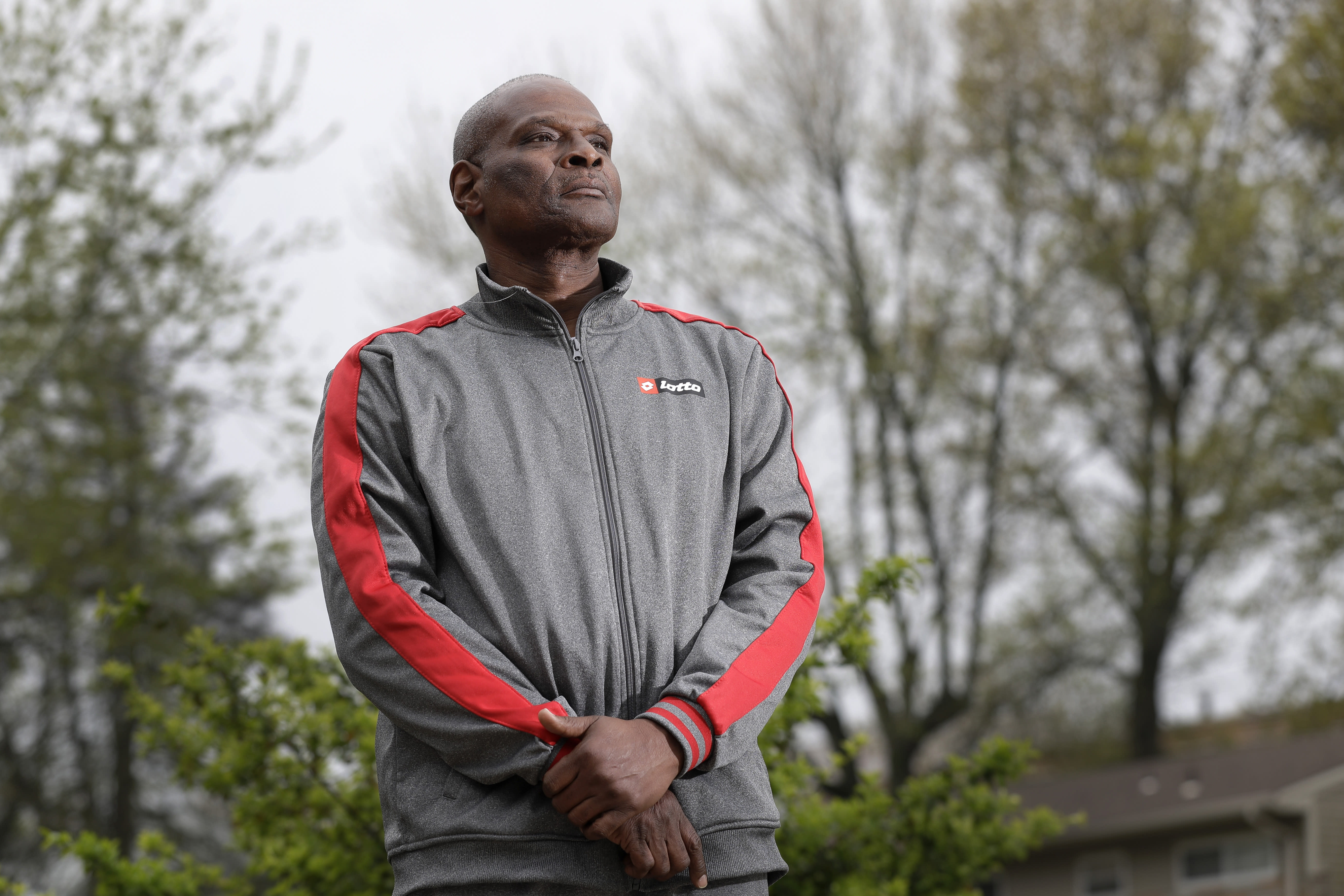 Randy Barnes poses for a photo outside his home Friday, April 17, 2020, in Dellwood, Mo. Barnes' older brother recently passed away after contracting COVID-19. (AP Photo/Jeff Roberson)