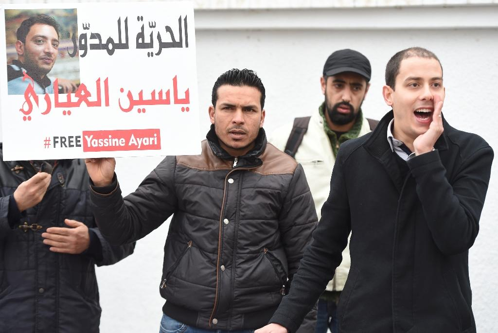 Tunisian protesters demonstrate in support of blogger Yassine Ayari in Tunis on February 24, 2015
