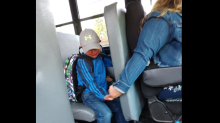 Mom captures heartwarming photo of son holding bus driver's hand on first day of school