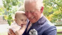 Never-before-seen images show Prince Charles affectionately with family
