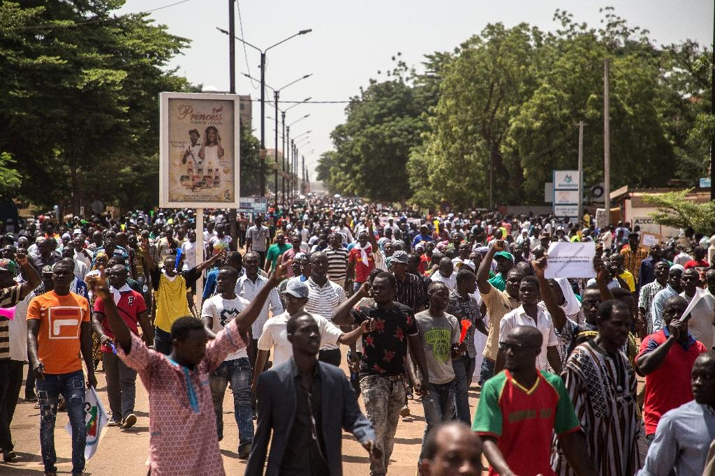 People gather during a rally in the Burkinabe capital Ouagadougou in the first large protest by opposition supporters against the current government's policy since the election of President Kabore in November 2015