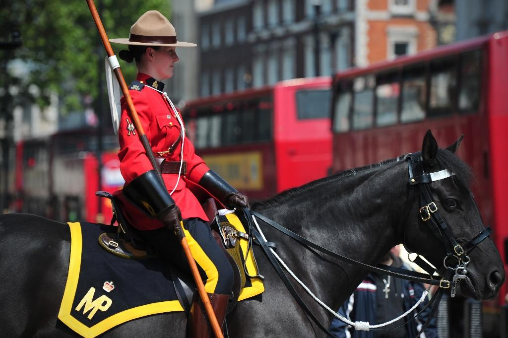 The Royal Canadian Mounted Police officer's uniform -- a red serge tunic, leather riding boots and wide-brimmed felt campaign hat -- is an iconic Canadian symbol