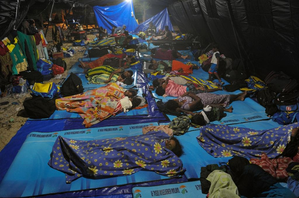 Sri Lankan migrants sleep in a tent in Lhoknga, Aceh on June 19, 2016 after being allowed to get off their stranded boat after it broke down nearly one week ago (AFP Photo/Chaideer Mahyuddin)