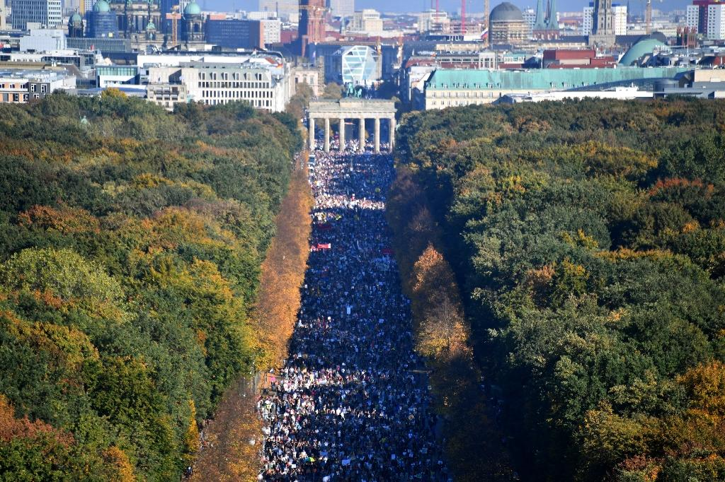 Demonstrators marched to Berlin's Brandenburg Gate where German groups performed a concert (AFP Photo/John MACDOUGALL)