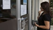 Squeezed by rates and technology, big banks are shuttering branches