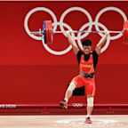 Li Fabin wins gold medal in weightlifting for China with a unique one-legged technique fans are calling the 'flamingo lift'
