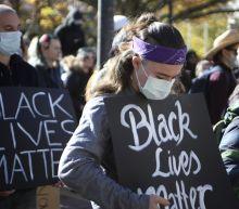 Australians rally for black lives, court bans bigger protest
