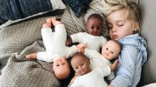 Little girl, 3, snuggling with diverse doll collection is giving the internet all the feels