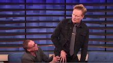 Jean-Claude Van Damme Majorly Caresses Conan O'Brien's Butt