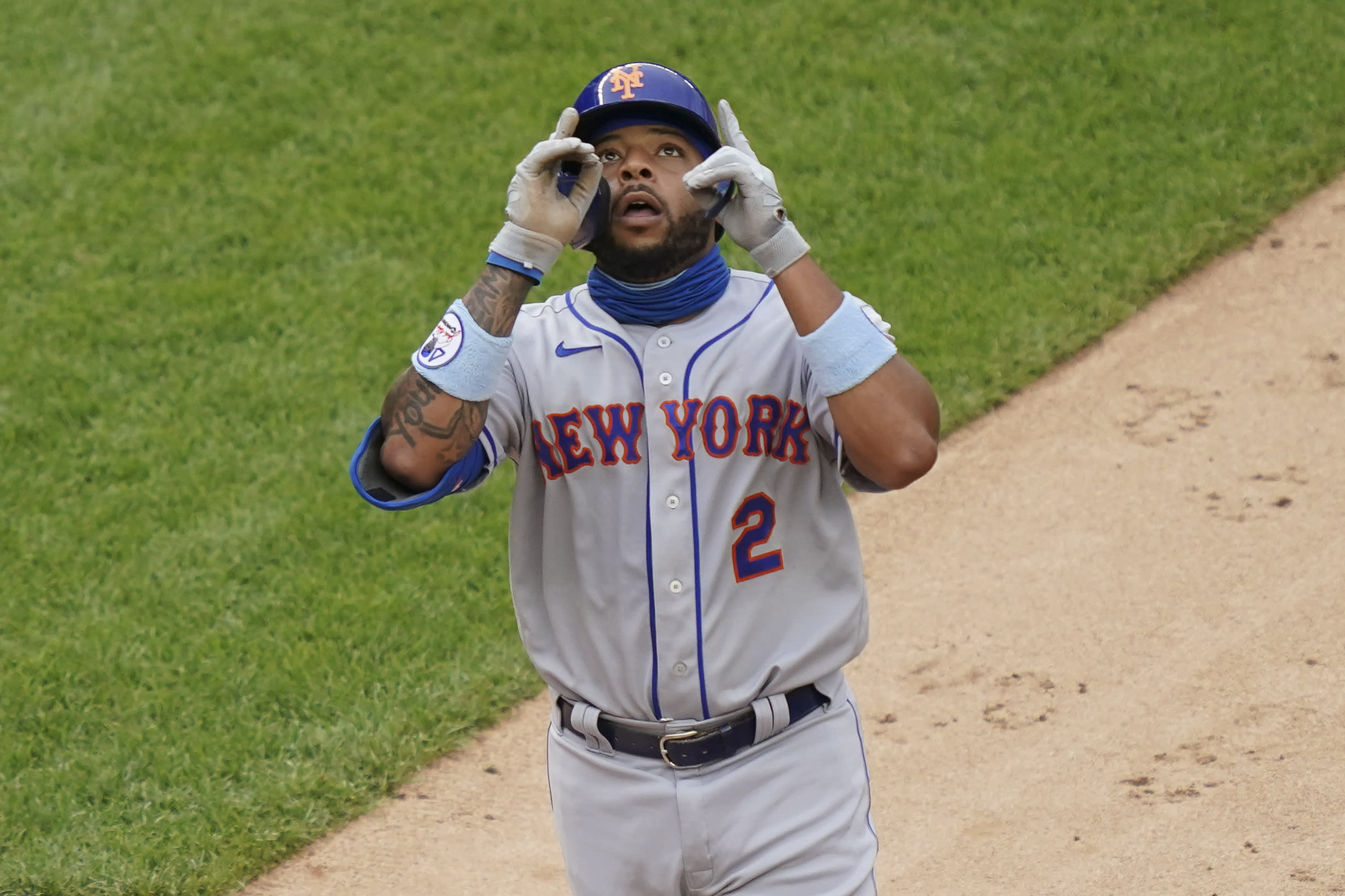 New York Mets' Dominic Smith celebrates after hitting a go-ahead solo home run off New York Yankees relief pitcher Chad Green in the sixth inning of the first baseball game of a doubleheader, Friday, Aug. 28, 2020, in New York. (AP Photo/John Minchillo)