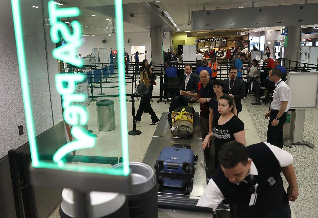 A US customs service IT glitch has left thousands of airline passengers waiting for clearance to enter the country Demonstrates Time Saving Travel Tips At Miami Airport