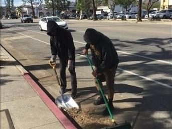 Jobs for the Homeless compensates homeless residents to help clean up the city.