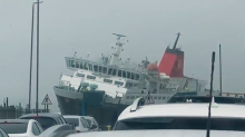 Storm Dennis: Ferry struggles to dock in dramatic video