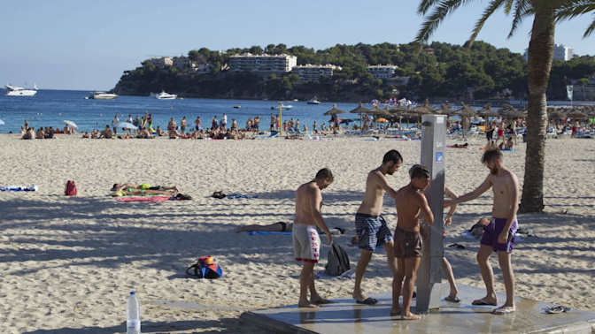 'Everyone out of the water!': Shark sparks panic at beach near Magalufin Majorca