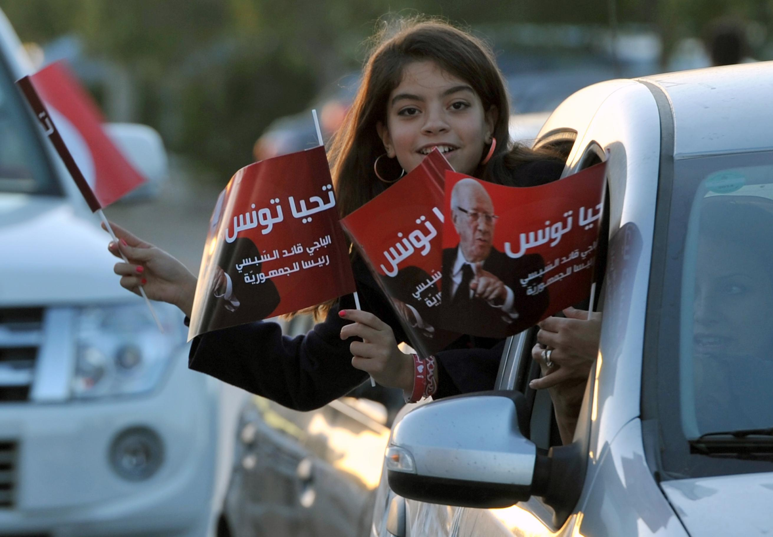 A young supporter of newly-elected President Beji Caid Essebsi celebrates his victory on December 22, 2014 in Tunis (AFP Photo/Fethi Belaid)