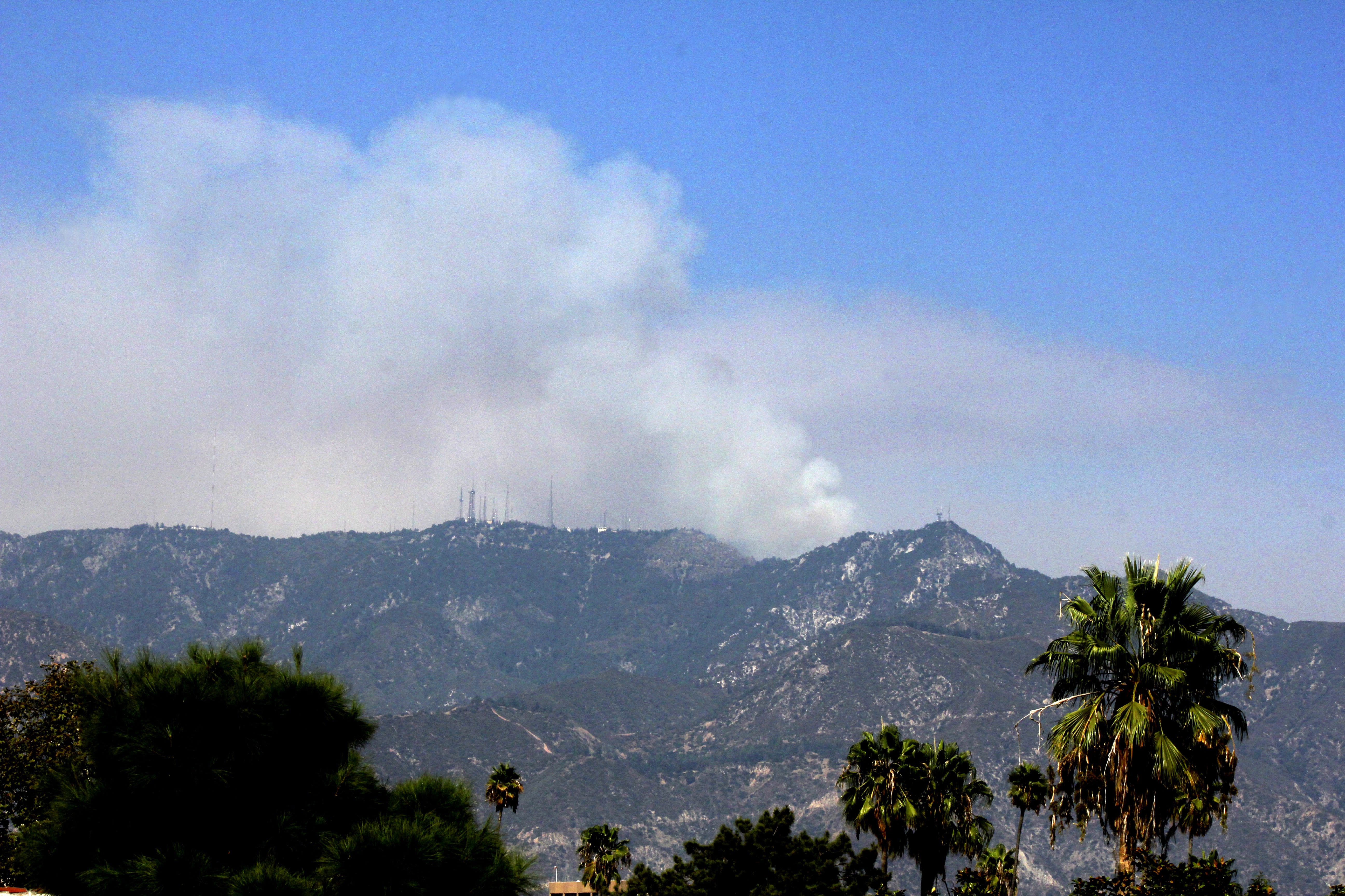 Smoke is seen from the Bobcat Fire burning actively near Mount Wilson northeast of Los Angeles on Thursday, Sept. 17, 2020. The peak is the site of historic Mount Wilson Observatory, which played a pivotal role in early 20th century astronomy. The fire also made a run at the peak earlier in the week but firefighters were able to defend the observatory. The fire also was active on the north side of the mountain range where authorities ordered evacuation of the community of Juniper Hills. (AP Photo/John Antczak)