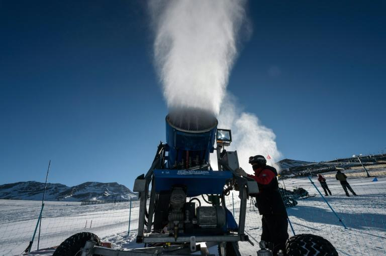 A cannon sprays artifical snow on a ski slope at El Colorado skiing center, in the Andes, some 30 km from Santiago