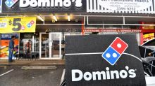Domino's profit dips as it acts on wages