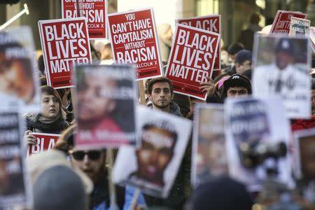Black Lives Matter protesters gather in Westlake Park near Westlake Mall during Black Friday in Seattle, Washington November 27, 2015. REUTERS/David Ryder
