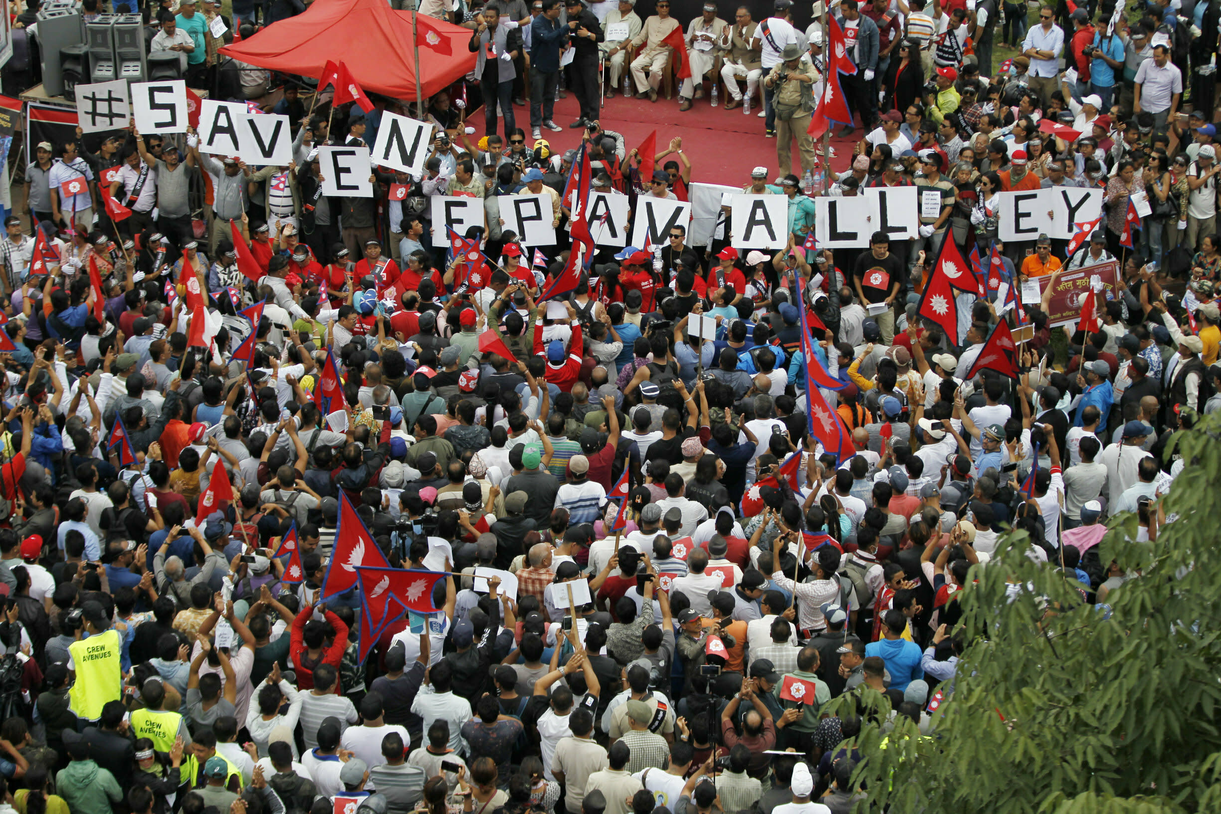Nepalese Newar community people gather during a protest against government in Kathmandu, Nepal, Wednesday, June 19, 2019. Thousands of people protested in the Nepalese capital to protest a Bill that would give government control over community and religious trusts. Protesters demanded the government scrap the proposed Bill to protect these trusts that hold religious ceremonies and festivals. (AP Photo/Niranjan Shrestha)