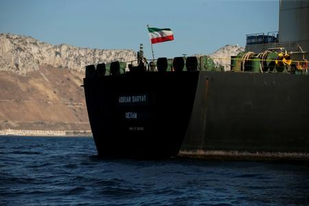 The Iranian flag flies on board the Iranian oil tanker Adrian Darya 1, formerly named Grace 1, as it sits anchored after the Supreme Court of the British territory lifted its detention order, in the Strait of Gibraltar