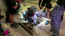 HK protesters attempt to escape through sewage
