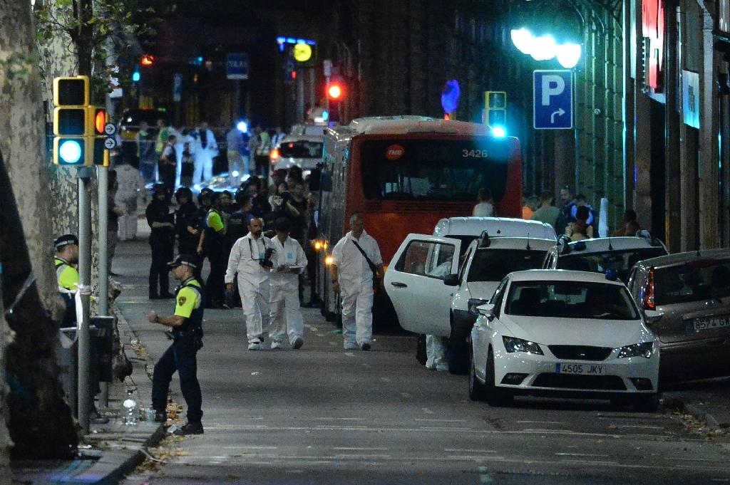 Forensic policemen arrive in the cordoned off area after the deadly jihadist attack using a van to plough down pedestrians on Las Ramblas boulevard in Barcelona last August 17