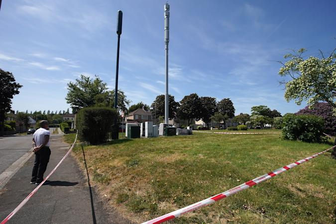 LIVERPOOL, ENGLAND - MAY 28: Fire and explosion damage can be seen on an EE network 5G mast that was attacked by an arsonist earlier this week in Brodie Avenue on May 28, 2020 in Liverpool, England. A lot of the damage was caused by the resulting explosion when the petrol was ignited. Several phone masts have been deliberately damaged around the UK, their attackers inspired by a conspiracy theory positing that 5G technology is linked to the spread of the coronavirus. (Photo by Christopher Furlong/Getty Images)