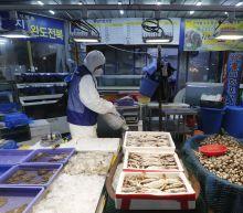 Virus pushes beyond Asia, taking aim at Europe, Mideast