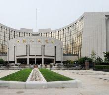 Asian markets mixed as Japan's economy skids, China cuts rates