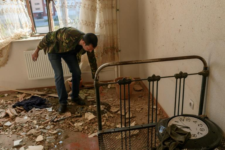 Movsumov Qowkar views the damage to his home inflicted during fighting over the breakaway region of Nagorno-Karabakh