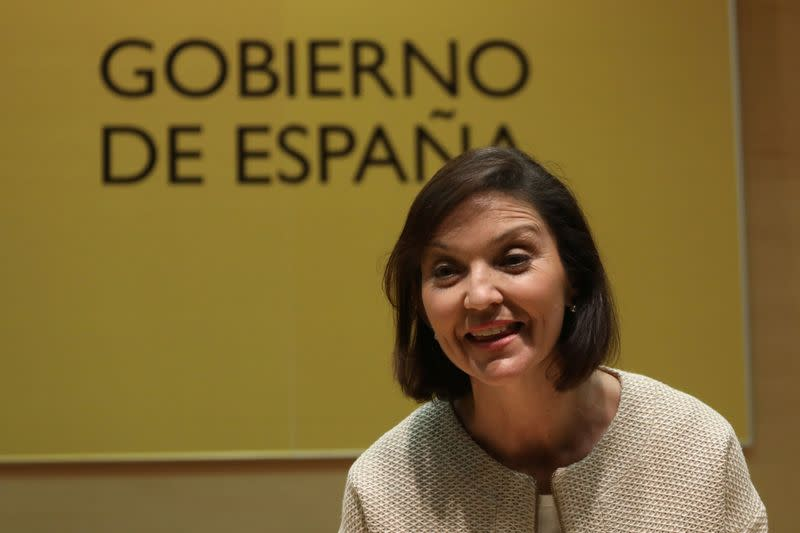 Spain's new Industry Minister Reyes Maroto reacts during her taking over ceremony at the Ministry of Economy in Madrid