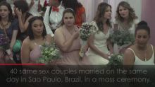 LGBT couples marry in protest against Brazil's Bolsonaro