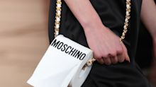 Moschino just debuted a toilet paper bag. Yes, seriously