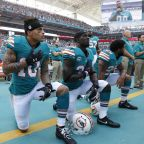 The Latest: Trump says NFL protesters should be suspended